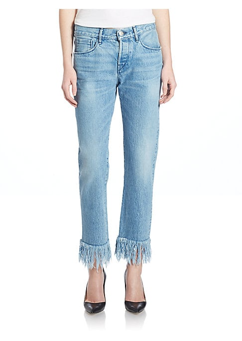 """Image of Attached fringe elevates these chic selvedge jeans. Belt loops. Button fly. Five-pocket style. Distressed details. Attached fringe at hem. Relaxed fit. Inseam, about 28"""".Cotton. Machine wash. Made in USA. Model shown is 5'10"""" (177cm) and wearing US size 4"""