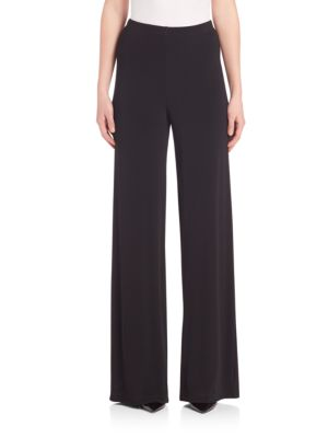 """Image of Wide-leg pant shaped in smooth matte jersey. Elasticized waist. Wide-leg silhouette. Pull-on style. Rise, about 12"""".Inseam, about 32"""".Viscose/elastane. Dry clean. Made in USA of Italian fabric. Model shown is 5'10"""" (177cm) wearing US size 4."""