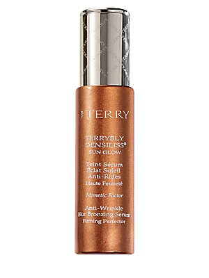 Image of WHAT IT IS From the Sun Cruise Collection. This tinted bronzing serum enriched in skincare benefits with wrinkle control, smoothing and firming properties, ensures a flawless sheer tan. Its exclusive DENSILISS® technology combines Mimetic Factor - a p