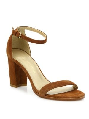 """Image of Block heel elevates minimalist suede sandal. Self-covered block heel, 3"""" (75mm).Suede upper. Open toe. Adjustable ankle strap. Leather lining and sole. Padded insole. Made in Spain."""