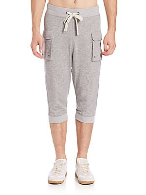"""Image of A pair of three-quarter length, below-the-knee pants featuring a low rise, functional pockets, and a comfortable, cotton construction. Drawstring at elasticized waist Side flap patch pockets Banded cuffs Inseam, about 16.5"""" Cotton Machine wash Imported. M"""