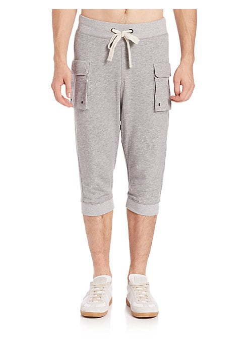 """Image of A pair of three-quarter length, below-the-knee pants featuring a low rise, functional pockets, and a comfortable, cotton construction. Drawstring at elasticized waist. Side flap patch pockets. Banded cuffs. Inseam, about 16.5"""".Cotton. Machine wash. Import"""