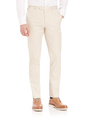 """Image of Slim fitting tailored pants with a bit of stretch. Belt loops. Zip fly with button tab closure. On-seam pockets. Back buttoned welt pockets. Slim fit. Unfinished hem. Rise, about 10"""".Inseam, about 37"""".Cotton/elastene. Dry clean. Made in Italy."""