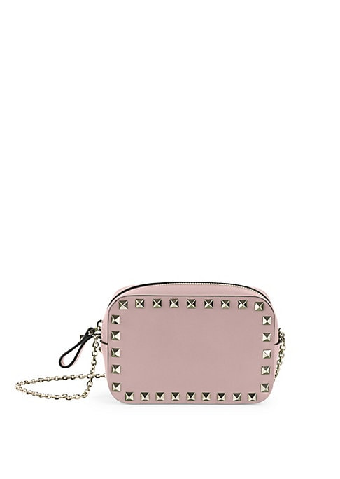 "Image of Studded leather pouch suspends from sleek chain strap. Chain shoulder strap, 24"" drop. Top zip closure. Goldtone hardware. Fully lined.4.5""W X 3""H X 2""D.Leather. Made in Italy."