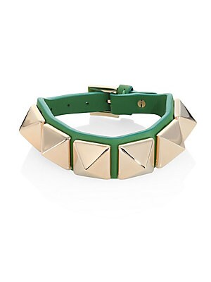 "Image of Rich leather bracelet set with bold pyramid studs Goldtone Leather Length, 8"" Adjustable buckle Made in Italy. Fashion Jewelry - Trend Jewelry. Valentino Garavani. Color: Marine."