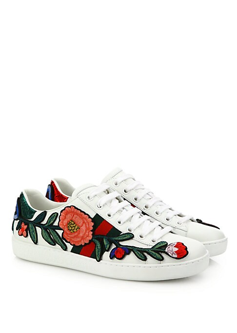 Image of Leather upper with embroidered floral applique. Round toe. Lace-up vamp. Red snakeskin detail on back of one shoe. Green snakeskin detail on back of other shoe. Leather lining. Rubber sole. Made in Italy.