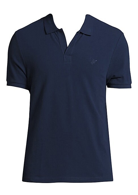 Image of Cotton pique polo with two eyelets on the back. Polo collar. Short sleeves with ribbed armbands. Pullover style. Cotton. Machine wash. Imported.