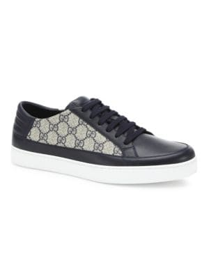 Image of Definitive style sneakers with padded leather detail. Canvas/leather upper. Lace-up closure. Leather lining. Rubber sole. Made in Italy.