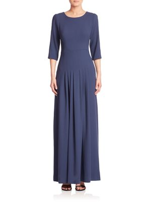 "Image of Sophisticated wool gown with pleated skirt. Roundneck. Three-quarter sleeves. Pleated skirt. Concealed back zip. Lined. About 59"" from shoulder to hem. Wool. Dry clean. Imported. Model shown is 5'10"" (177cm) wearing size 4."