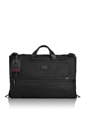 Image of Stylish and easily portable, this garment bag features multiple compartments to effectively store your accessories and essentials. Dual top handles. Removable shoulder strap. Zipper with buckle strap closure. Three outside zip pockets. Inside zip compartm