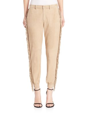 Image of Made from luxe suede, this refined pant is perfect for brunch or visiting your favorite gallery downtown. Designed with a sleek boyfriend fit, it's trimmed with eye-catching fringe that sways with every step. Ultra-stylish luxe suede pants with side fring