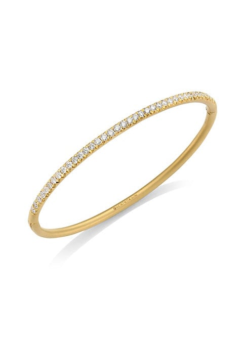 Image of Brilliant diamonds punctuate a sleek 18 karat yellow gold bar to create this impossibly chic Moderne bracelet, signaling well-structured style at its best. Ultra-refined with a striking simplicity, this bracelet exudes covetable contemporary glamour for d
