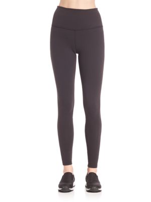 "Image of Breezy leggings with mesh and cross elastic panels. Elasticized lower back panels. High waist style. Rise, about 6"".Inseam, about 26"".Supplex/lycra. Machine wash. Made in USA. Model shown is 5'10"" (177cm) wearing US size Small."