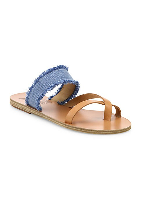 Image of Frayed light-wash denim and leather revamp slides. Leather and fabric upper. Crisscross toe ring. Slip-on style. Leather sole. Made in Greece.