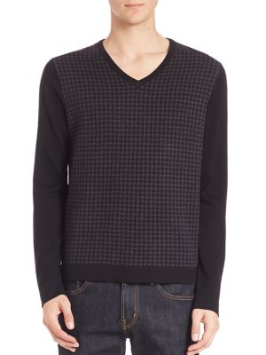 Image of EXCLUSIVELY OURS. Comfy houndstooth pattern sweater cast in merino wool. Ribbed V-neck. Long sleeves with ribbed cuffs. Pullover style. Ribbed hem. Merino wool. Dry clean. Imported.
