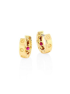 "Image of From the Symphony Collection Gleaming gold huggy hoops with dimpled dot design 18k yellow gold Signature synthetic ruby detail at interior Diameter, about 0.75"" Hinged post back Made in Italy. Fine Jewelry - Roberto Coin Asset. Roberto Coin. Color: Gold."