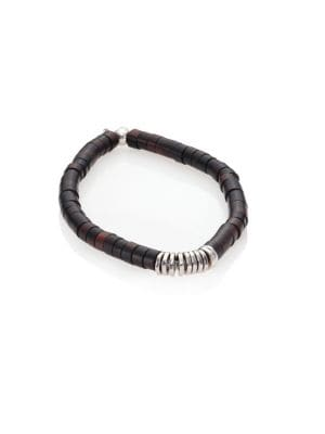 """Image of Beaded bracelet finished with shiny silver discs. Silver. Ebony wood. Diameter, about 3"""" .Made in UK."""