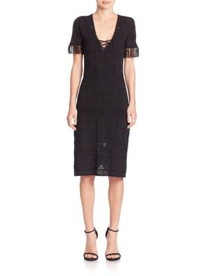 "Image of Allover cutouts style this glamorous A-line dress. Plunging V-neck. Lace-up front. Short sleeves. Pullover style. Lined. About 41"" from shoulder to hem. Rayon/nylon. Dry clean. Imported. Model shown is 5'10"" (177cm) wearing size Small."