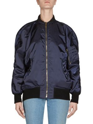 """Image of Reversible bomber jacket with ruched detailing. Stand collar. Long sleeves. Concealed front zip. Zip pocket at sleeve. Front flap pockets. Front zip pocket. About 25"""" from shoulder to hem. Polyester. Dry clean. Made in Italy. Model shown is 5'10"""" (177cm)"""