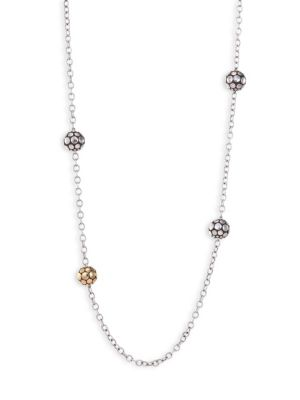 "Image of From the Dot Collection. Long chain with dotted silver and gold sphere stations.18K yellow gold. Sterling silver. Length, 36"".Lobster clasp. Imported."