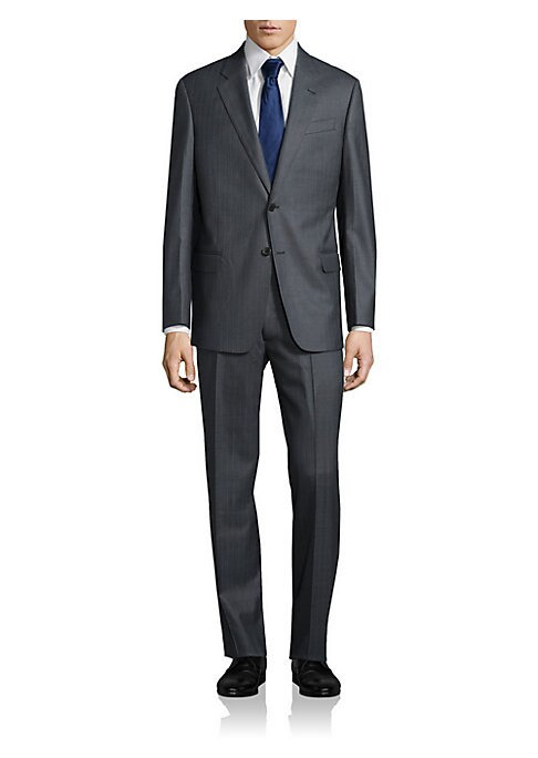 """Image of Expertly-tailored dress staple in refined wool. Dry clean. Imported. JACKET. Notch lapel. Button front. Chest welt pocket. Waist flap pockets. Long sleeves. Buttoned cuffs. Lined. About 30"""" from shoulder to hem. PANTS. Flat-front style. Zip fly. Side slas"""