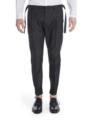 Image of Cozy wool-blend biker pants with stylish side tabs. Belt loops. Zip fly with hook-and-bar closure. Slash pockets. Back buttoned welt pockets. Rolled cuffs. Virgin wool/silk. Dry clean. Made in Italy.