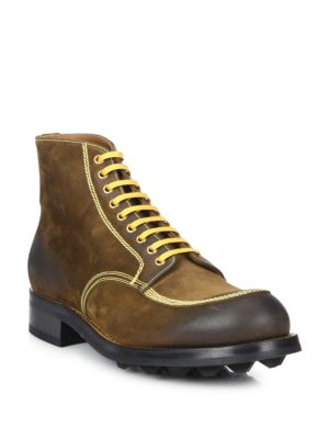Image of Fashionable ankle boots in burnished suede. Leather upper. Round toe. Lace-up style. Leather lining. Rubber sole. Made in Italy.