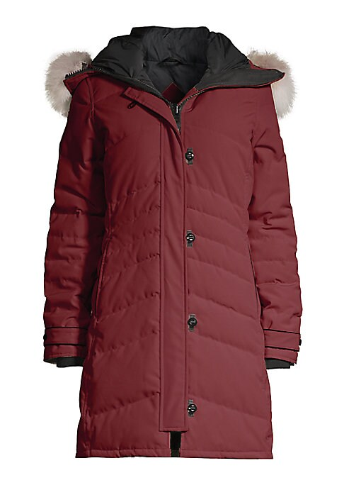 Image of From the Arctic Tech Collection. Warm down filled quilted coat accentuated with fur-trim hood. Thermal experience index: fundamental warmth, 15?F to -5?F.Attached drawstring hood. Removable fur trim. Long sleeves with ribbed and button tab cuffs. Conceale