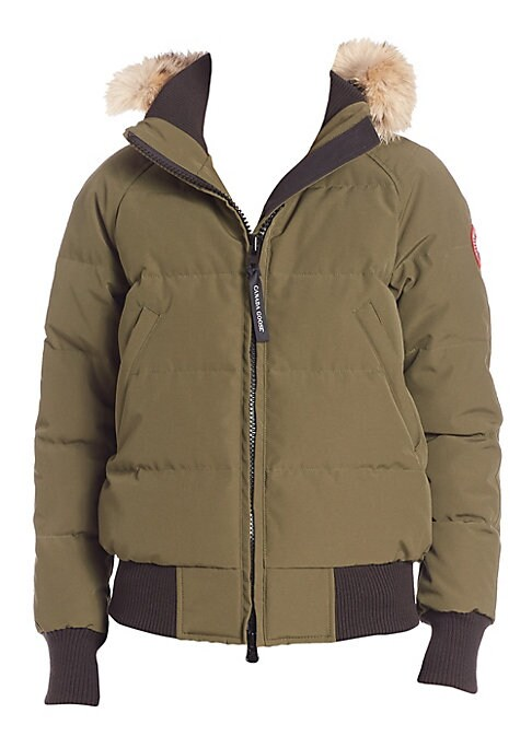 Image of From the Arctic Tech Collection. Utilitarian bomber jacket with fur-trimmed hood. Thermal experience index: fundamental warmth, 15?F to -5?F.Attached hood with removable fur trim. Long sleeves with rib-knit cuffs. Two-way locking front zip closure. Front