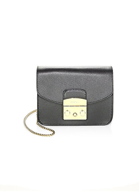 """Image of Mini leather crossbody accented with polished hardware. Chain shoulder strap, 22"""" drop. Push-lock flap closure. Silvertone hardware. One inside open pocket. Fully lined.6.5""""W X 4.75""""H X 3""""D.Leather. Made in Italy."""