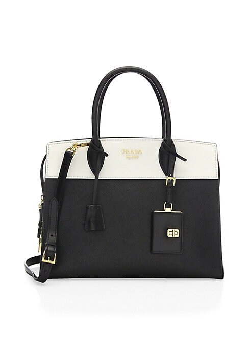 """Image of Structured satchel of mixed saffiano and leather construction. Double top handles, 4.75"""".Removable, adjustable shoulder strap, 41"""" drop. Top zip closure. Goldtone hardware. One interior zip pocket. Two interioropen pockets. Prada logo lining. Dust bag and"""