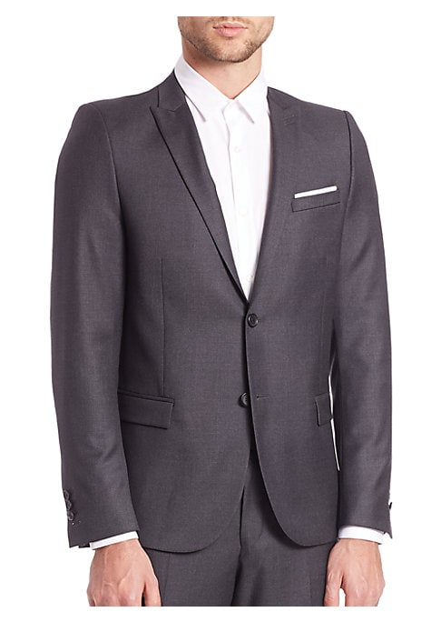 """Image of Tailored to a slim, preferred fit in superior wool. Notch lapel. Button front. Chest welt pocket. Waist flap pockets. Long sleeves. Buttoned barrel cuffs. Lined. About 28"""" from shoulder to hem. Wool. Dry Clean. Imported."""