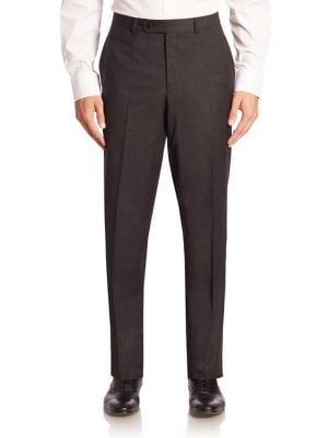 """Image of EXCLUSIVELY OURS. Miniature checks style these plush wool trousers. Belt loops. Zip fly with button closure. Slash pockets. Back buttoned welt pockets. Rise, about 10"""".Inseam, about 37"""".Wool. Dry clean. Made in Canada."""