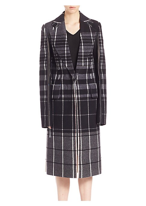 """Image of Tailored plaid wool coat with leather contrast. Notch lapels. Long sleeves with leather contrast. Concealed front closure. Flap waist pockets. Back vent. About 40"""" from shoulder to hem. Virgin wool/leather. Dry clean by leather specialist. Made in Italy."""