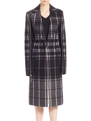 "Image of Tailored plaid wool coat with leather contrast. Notch lapels. Long sleeves with leather contrast. Concealed front closure. Flap waist pockets. Back vent. About 40"" from shoulder to hem. Virgin wool/leather. Dry clean by leather specialist. Made in Italy."