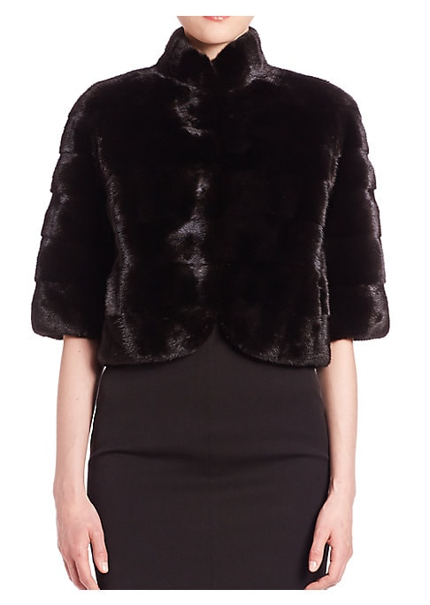"Image of EXCLUSIVELY AT SAKS FIFTH AVENUE. Cropped staple in plush mink fur. Stand collar. Elbow-length sleeves. Concealed front hook-and-eye closure. Lined. About 19"" from shoulder to hem. Fur type: Dyed mink. Fur origin: Denmark. Dry clean by fur specialist. Imp"