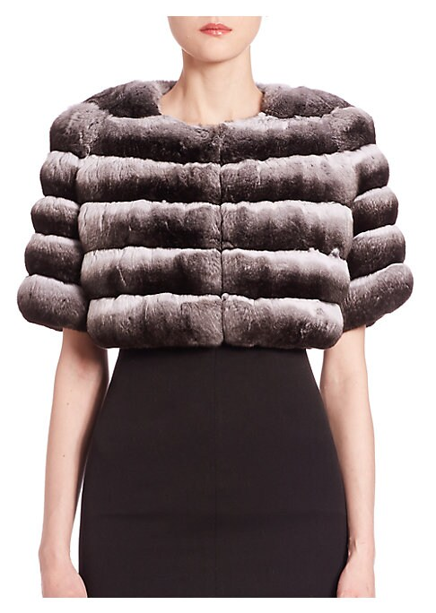 "Image of EXCLUSIVELY AT SAKS FIFTH AVENUE. Plush chinchilla fur bolero for luxe layering. Roundneck. Short sleeves. Concealed hook-and-eye closure. Silk lining. About 14"" from shoulder to hem. Fur type: Chinchilla with brightener added. Fur origin: Argentina. Dry"