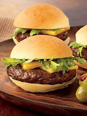 "Image of Juicy and flavor-intense, these ready-to-cook Wagyu beef sliders will be an instant hit. Includes: 25 sliders Five 10 oz packages containing five sliders Serves: 16-25 people Shelf life: 12 months frozen, 5-7 days refrigerated Frozen, ready-to-cook 10"" x"