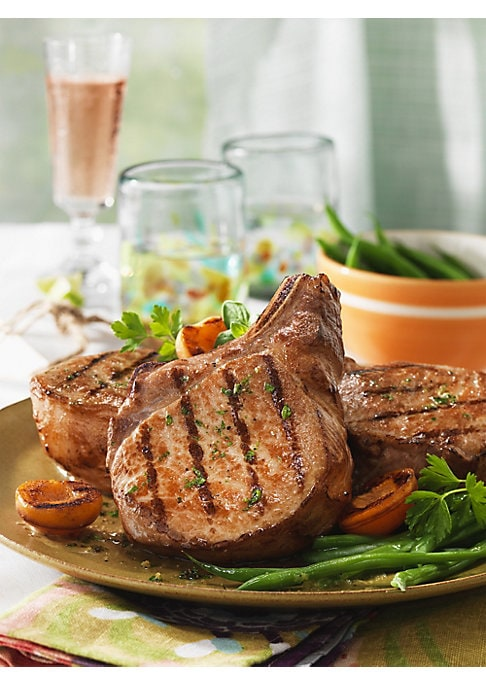 "Image of Delicious dry-aged Berkshire pork chops. Includes: 4 chops. Frozen, ready to cook.12 oz. each. Shelf life: 12 months frozen, 5-7 days refrigerated. Serves: 4.10"" x 8"" x 4"".Made in USA. SPECIAL PROCESSING & DELIVERY. This item ships from vendor and require"
