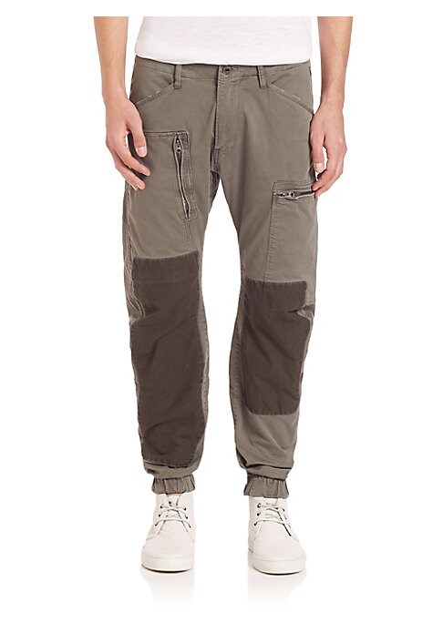 "Image of Casual staple with knee patches and multiple pockets. Belt loops. Zip fly with button closure. Two side pockets. Two zipped pack pockets. Two cargo pockets. Dark knee patches. Tapered ankle. Rise, about 10"".Inseam, about 27"".Leg opening, about 10"".Cotton/"