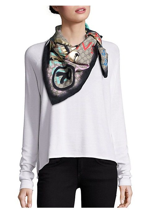 """Image of From the Gucci Ghost Collection. GG silk scarf with graffiti-inspired graphics.35""""W X 35""""L.Silk. Dry clean. Made in Italy."""