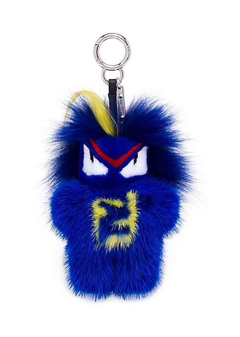 "Image of .Vibrant fur monster eye key charm.6"" long. Fur type: Dyed mink. Fur origin: Finland. Fur type: Dyed fox. Fur origin: Finland. Fur type: Dyed goat. Fur origin: China. Made in Italy."