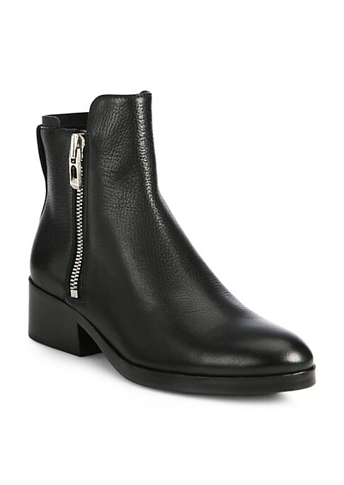 """Image of .Tough moto boot pared down in luxe pebbled leather. Stacked heel, 1.5"""" (40mm).Leather upper. Round toe. Side zippers. Leather lining and sole. Padded insole. Made in Italy."""