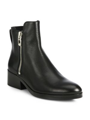 "Image of .Tough moto boot pared down in luxe pebbled leather. Stacked heel, 1.5"" (40mm).Leather upper. Round toe. Side zippers. Leather lining and sole. Padded insole. Made in Italy."