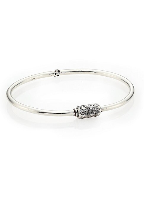 Image of From the Herman Collection. Polished bangle with intricately engraved barrel. Sterling silver. Barrel clasp. Made in USA.
