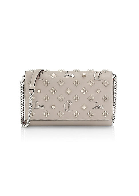 "Image of Artfully studded clutch with removable chain strap. Removable chain crossbody strap, 20"" drop. Magnetic snap-flap closure. Goldtone hardware. One inside billfold. One inside gusset pocket. One inside zip pocket. Ten inside credit card slots. Signature red"