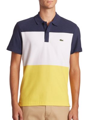 """Image of Bold colorblocking on a regular fit polo shirt. Polo collar. Button placket. Signature logo applique on the chest. Short sleeves. Even vented hem. About 27"""" from shoulder to hem. Cotton. Machine wash. Imported."""