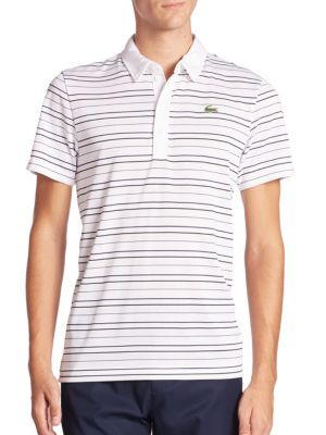"""Image of Lively stripes uplift this moisture wicking polo. Polo collar. Front button placket. Signature logo applique on the left chest. About 28"""" from shoulder to hem. Polyester. Machine wash. Imported."""