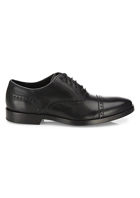 Image of Brogue oxfords designed with Grand OS technology. Leather upper. Cap toe. Leather/fabric lining. Rubber sole. Imported.