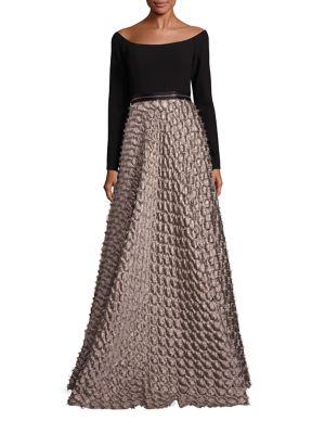 "Image of Textured full skirt defines shoulder-baring gown. Off-the-shoulder neckline. Long sleeves. Banded waist with zip detail. Textured skirt. Concealed back zip closure. About 62"" from shoulder to hem. Polyester. Dry clean. Imported. Model shown is 5'10"" (177c"
